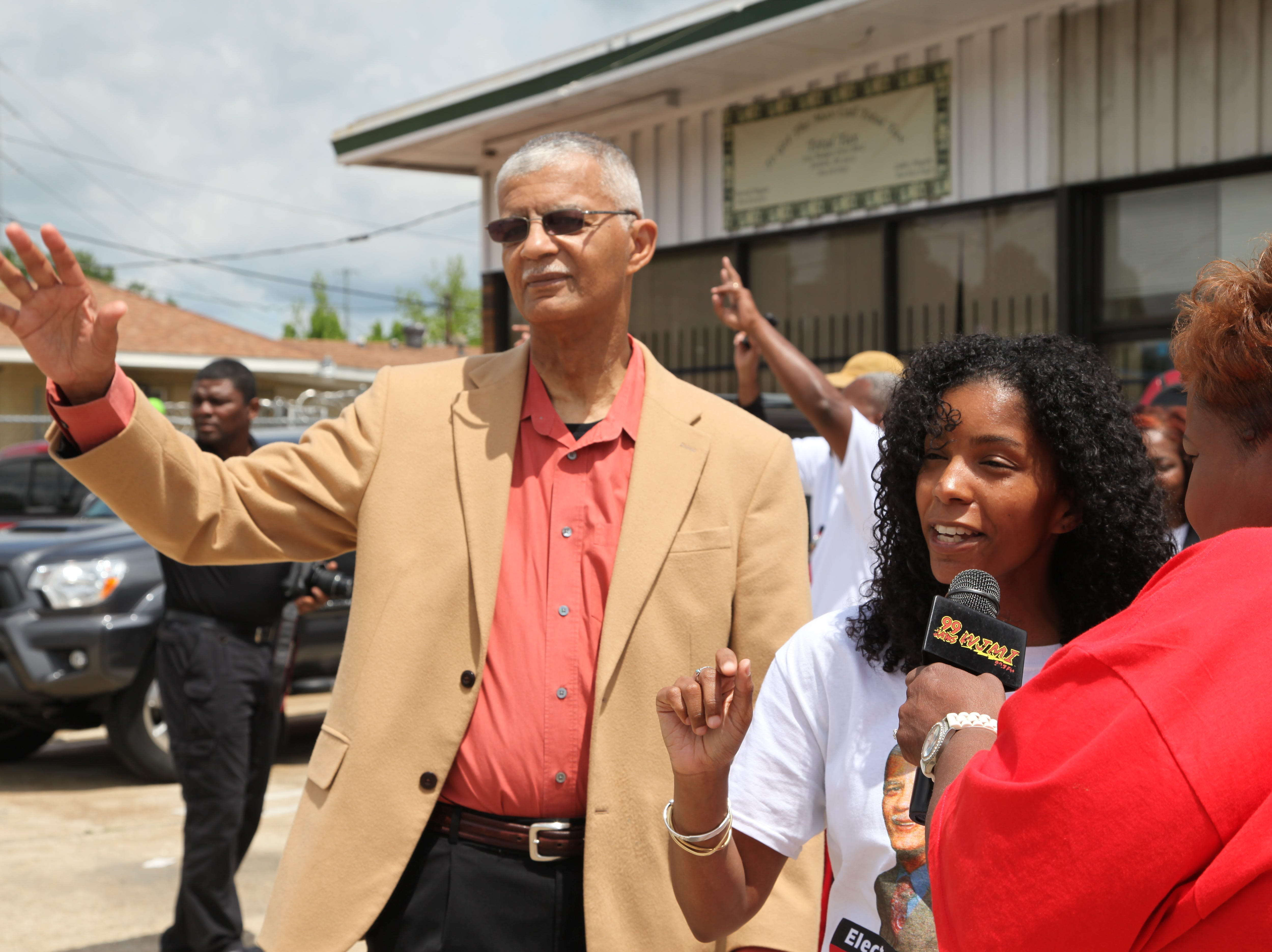 Jackson mayoral candidate Chokwe Lumumba and his daughter, Rukia Lumumba, are interviewed at campaign headquarters by 99.7 FM, WJMI.