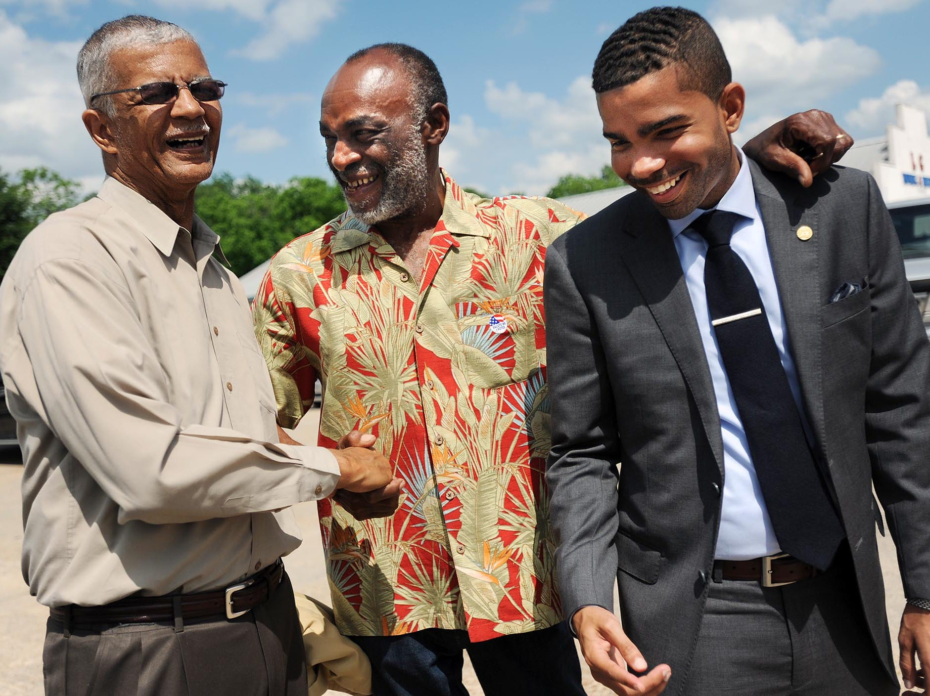 Mayoral candidate Chokwe Lumumba (left) shares a light moment with Rep. James Evans, D-Jackson and Lumumba's son Chokwe Antar Lumumba Tuesday afternoon. The elder Lumumba is in a runoff race against candidate Jonathan Lee.