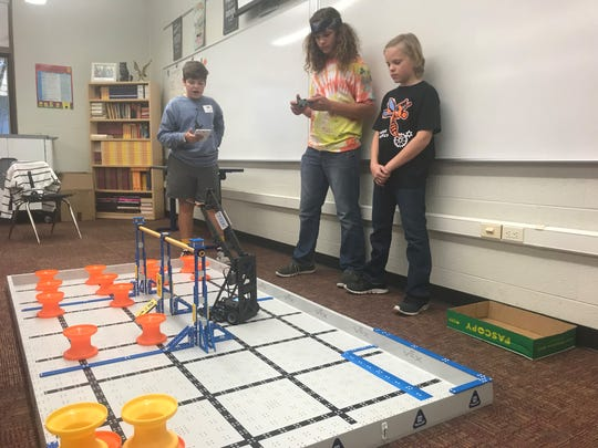 Two members of the robotics team at South Gibson County Middle School practice with their robot at a tournament in Brentwood earlier in the school year.