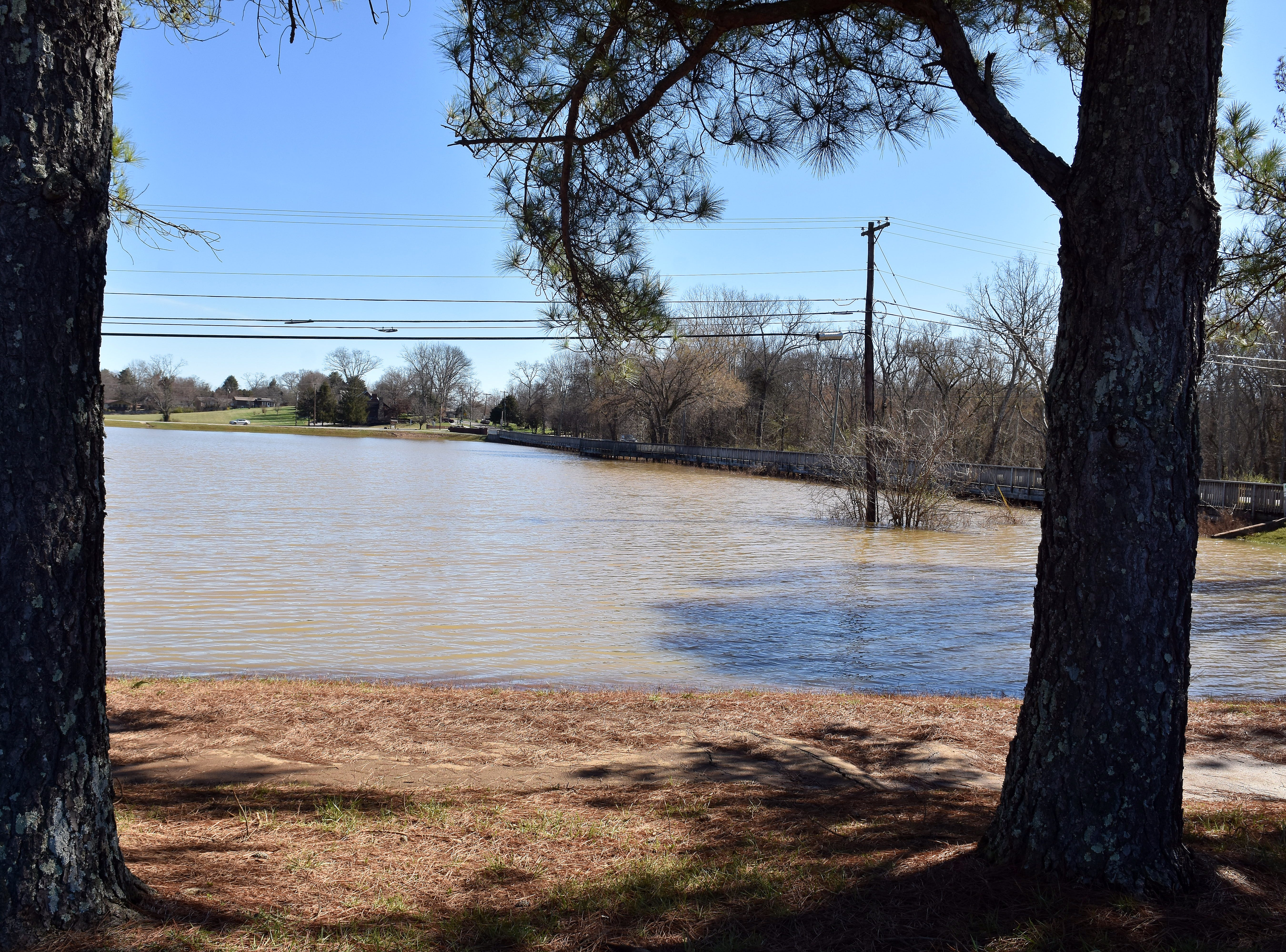 The field between Broadacres and Powell Middle School on Emory Road is filled with flood waters.