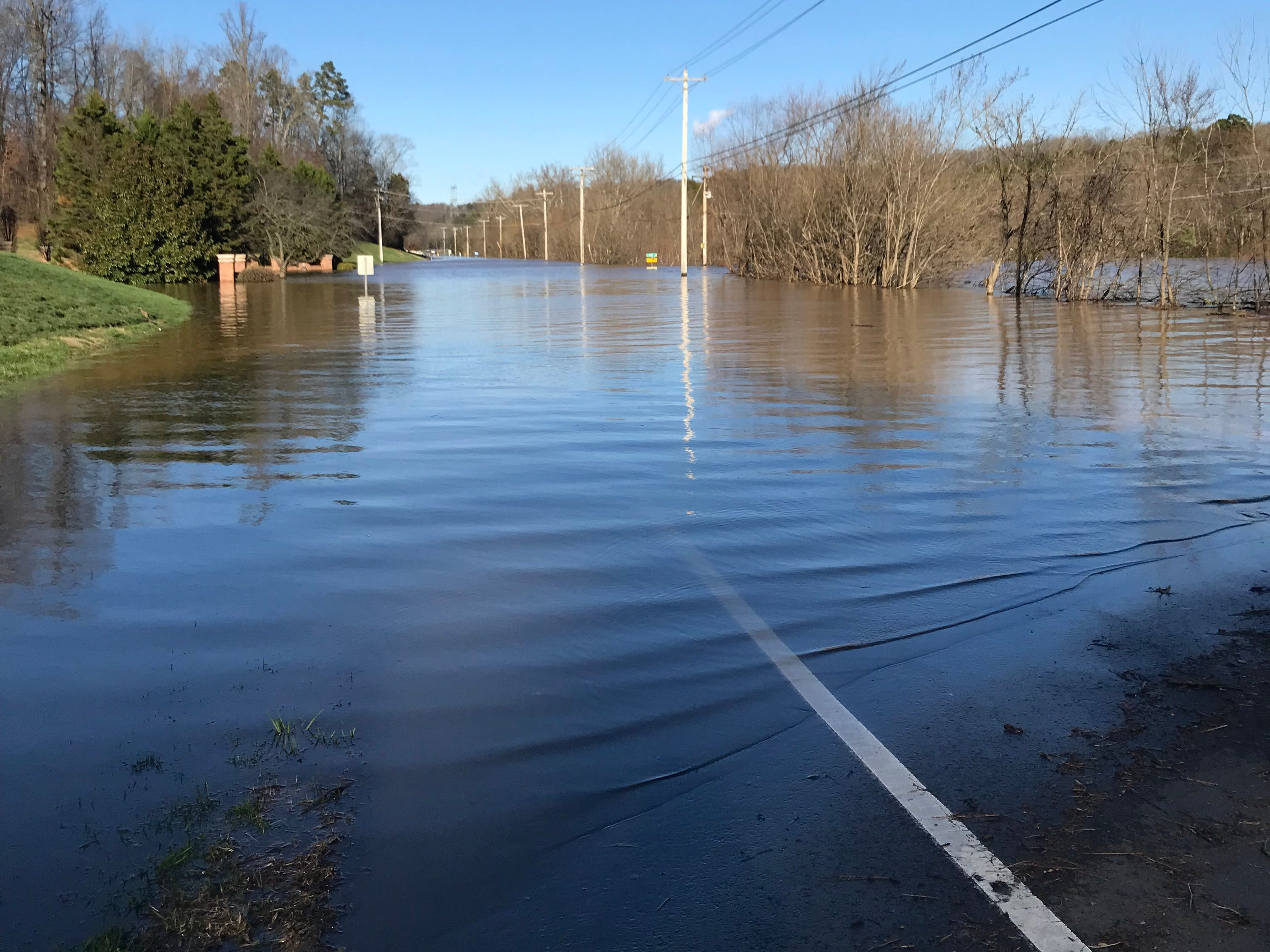 Northshore Drive, usually a busy state two-lane road in west Knox County, was a large lake at the most western entrance of the Whittington Creek subdivision late Sunday afternoon. Street signs were barely above water.