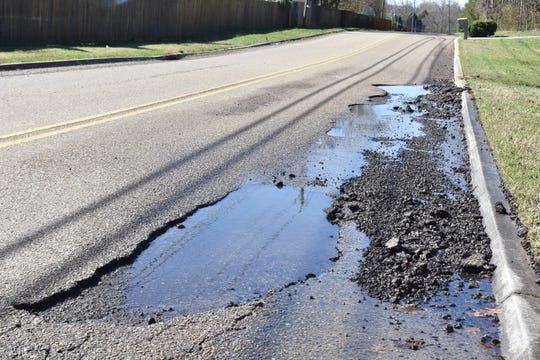 This large pothole takes up half of one lane on Dante Road in Powell.