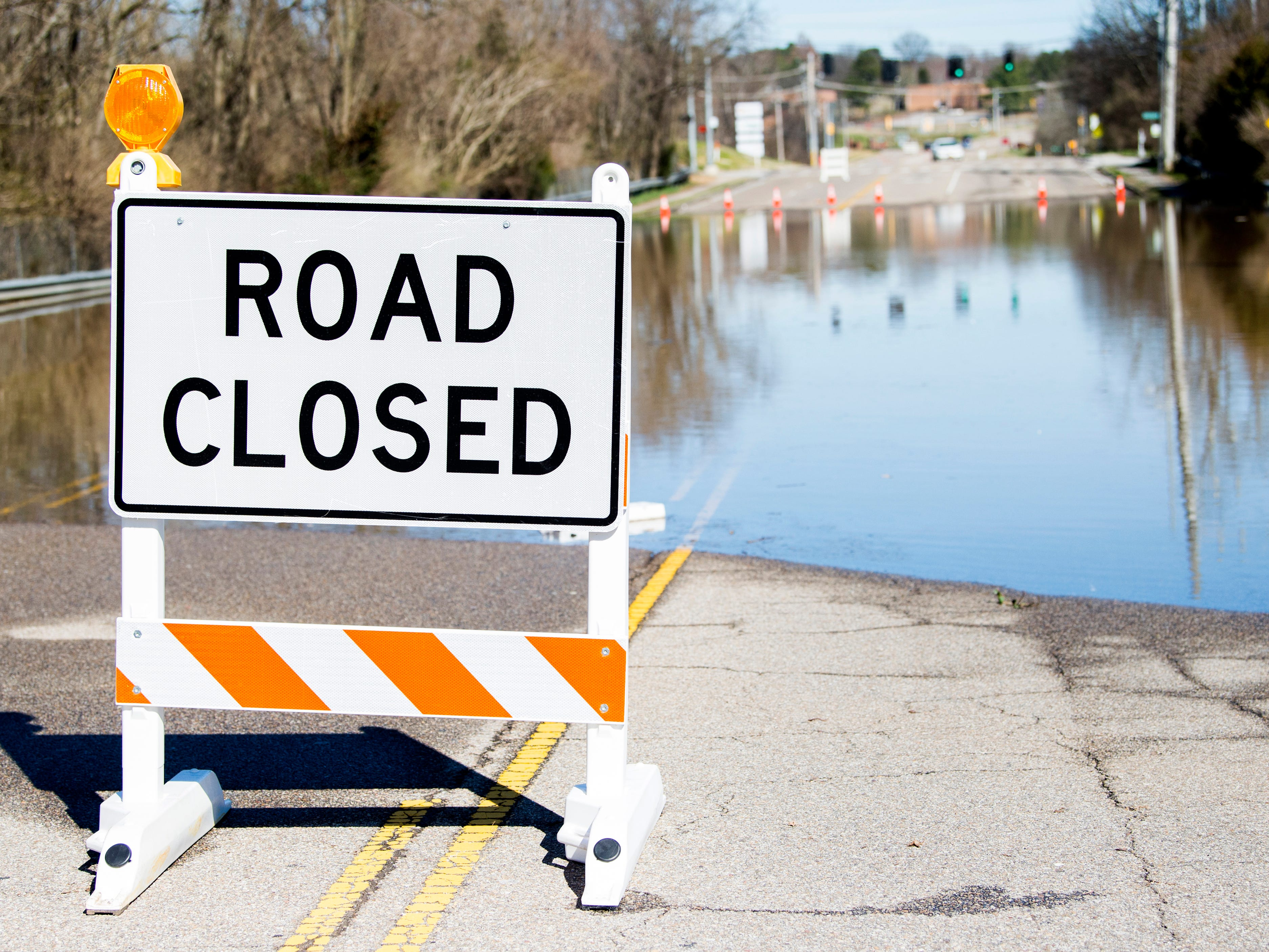 Water continues to flood parts of North Cedar Bluff Road, including this section between Sherrill Boulevard and Dutchtown Road, on Monday, Feb. 25, 2019.