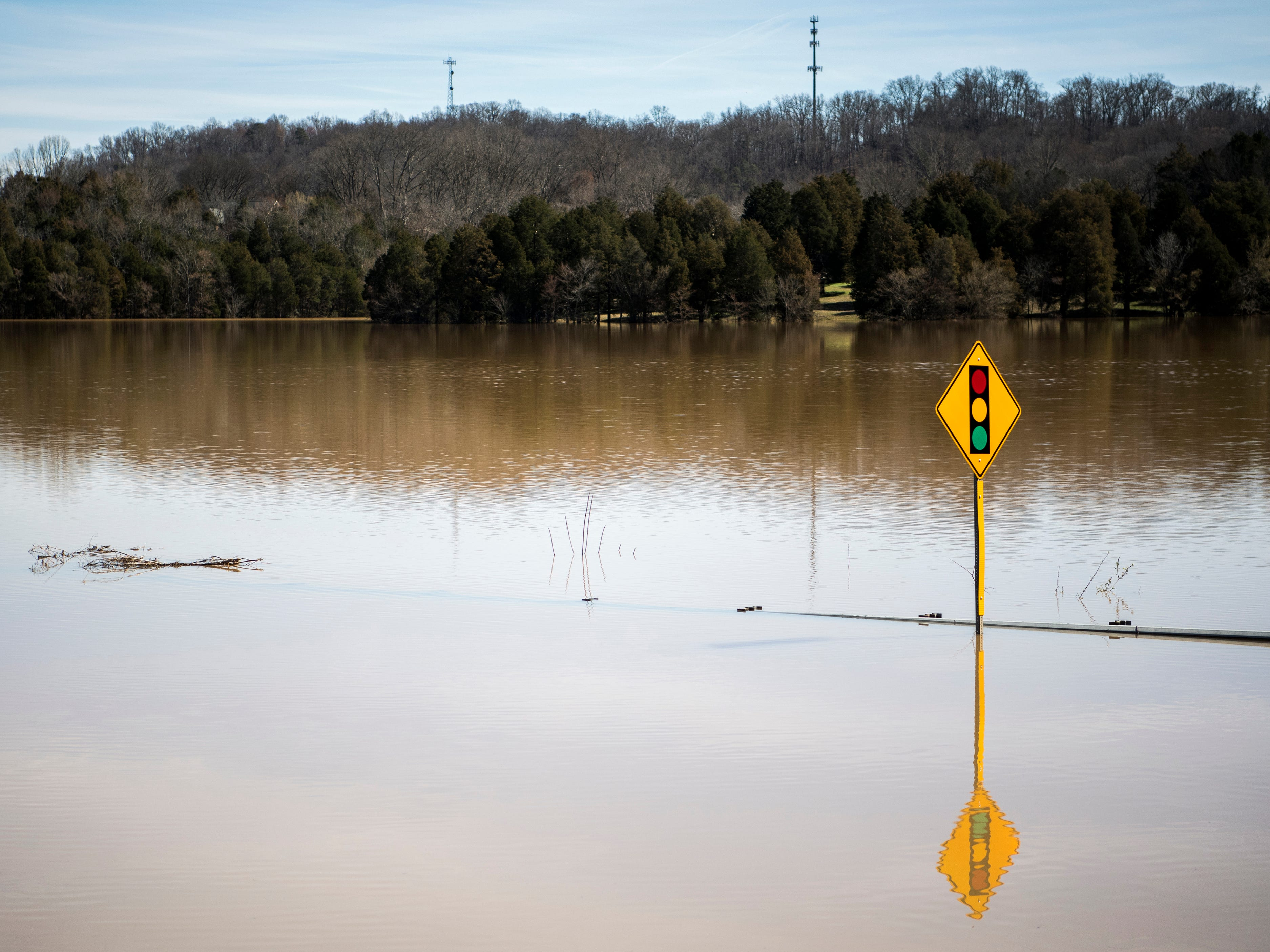 Water continues to flood Northshore Drive near the intersection of Northshore Drive and Ebenezer Road on Monday, February 25, 2019.