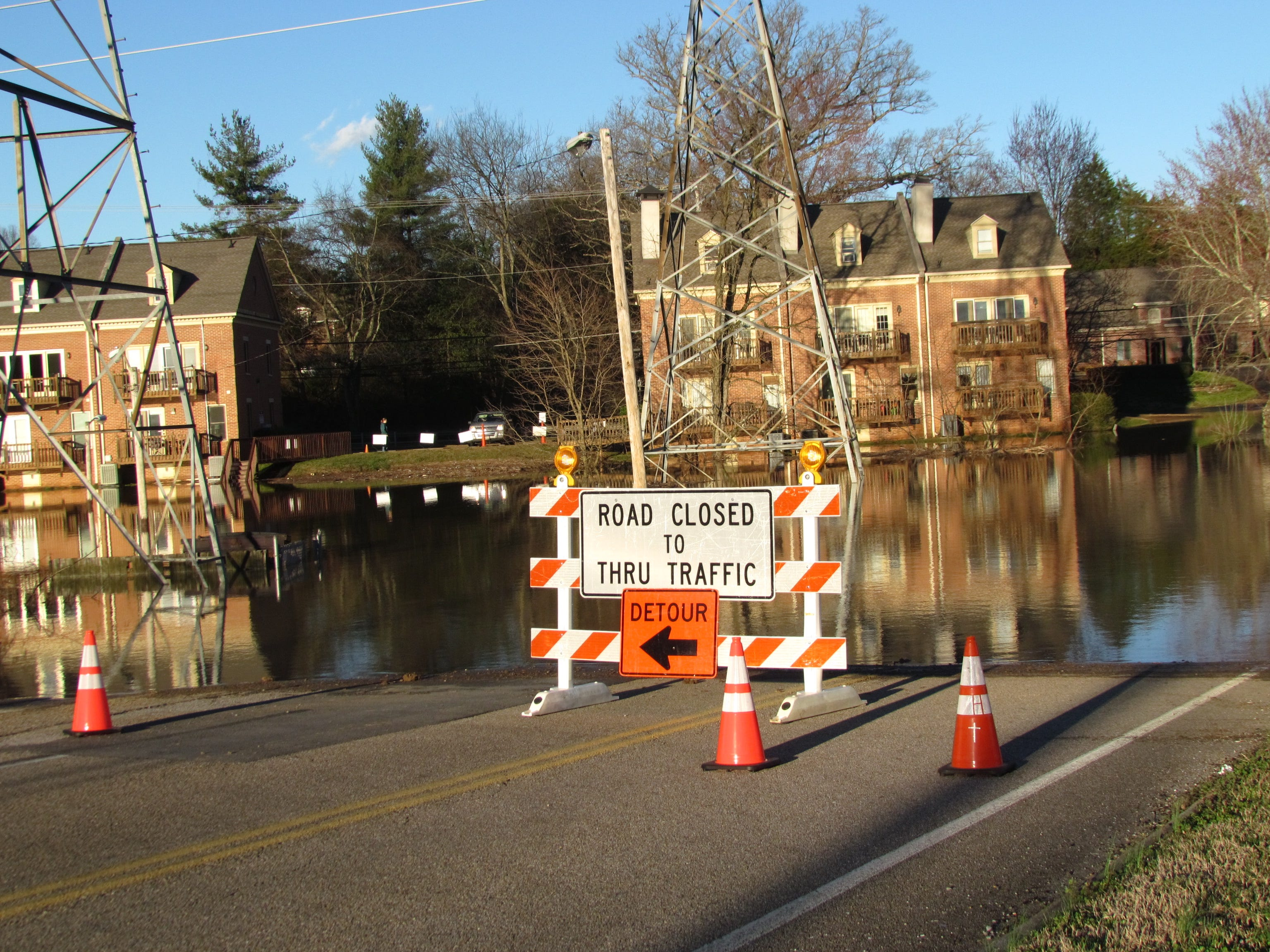 Floodwaters from Sinking Creek overflow across George Wililams Road in West Knoxville on Sunday, February 24, 2019.