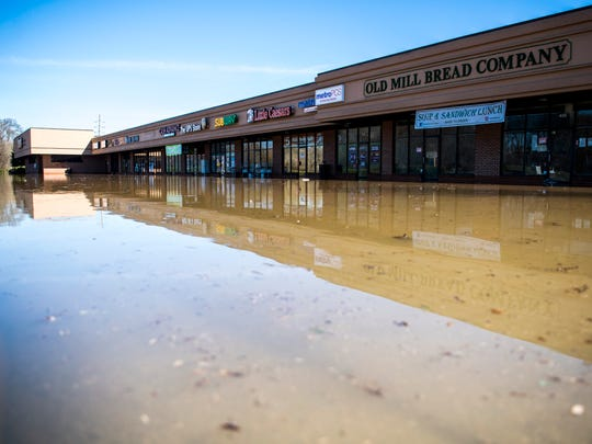 Water continues to flood the North Cedar Bluff Plaza shopping center along N. Cedar Bluff Road on Monday, February 25, 2019.