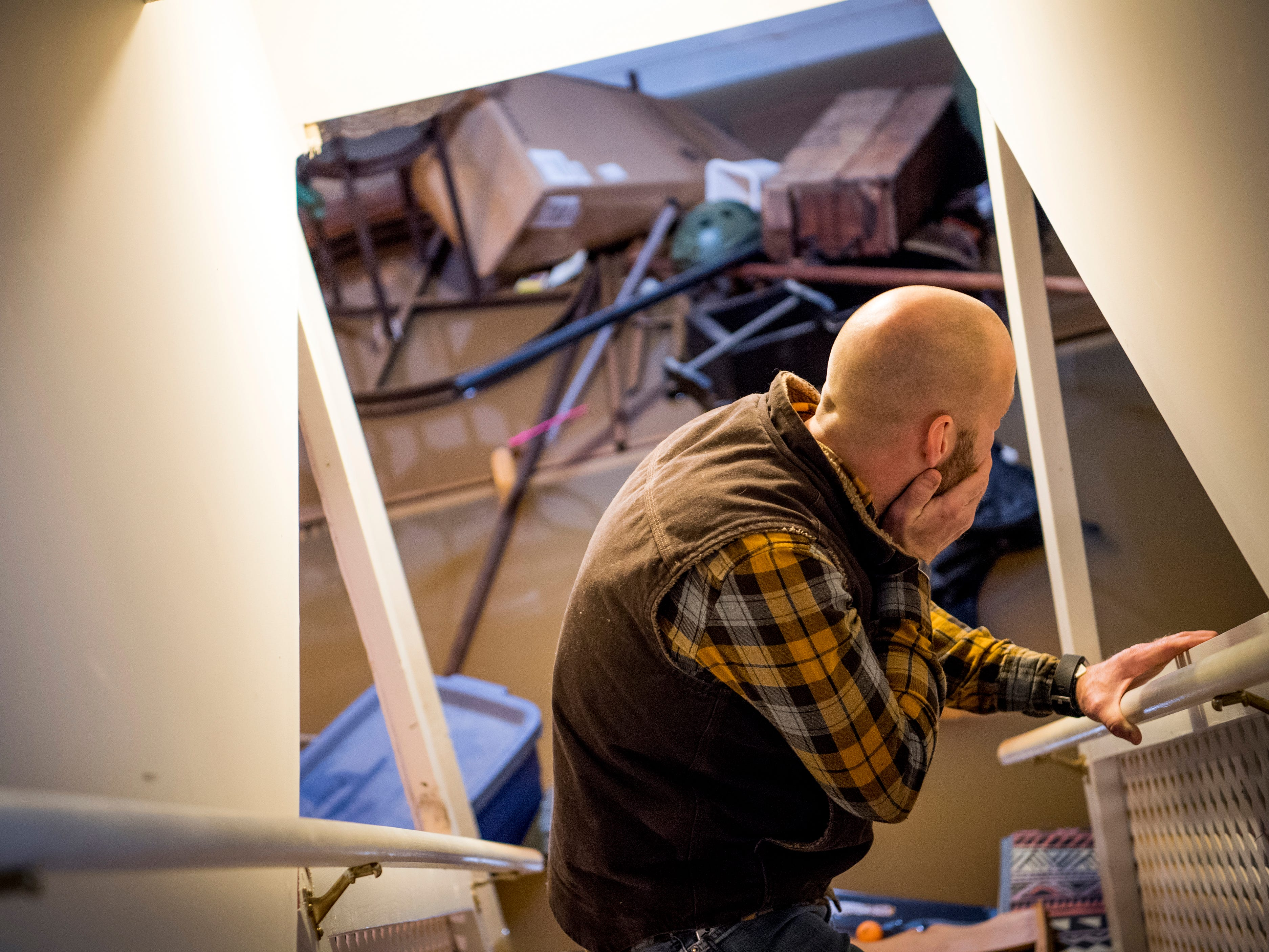 Jeff Macklin rubs his face as he realizes certain items were in his basement when it flooded while surveying his basement on Monday, February 25, 2019. Macklin lives in the Lennox Place subdivision off of Ebenezer Road in Knoxville, and parts of Ebenezer Road were still under several feet of water on Monday afternoon.