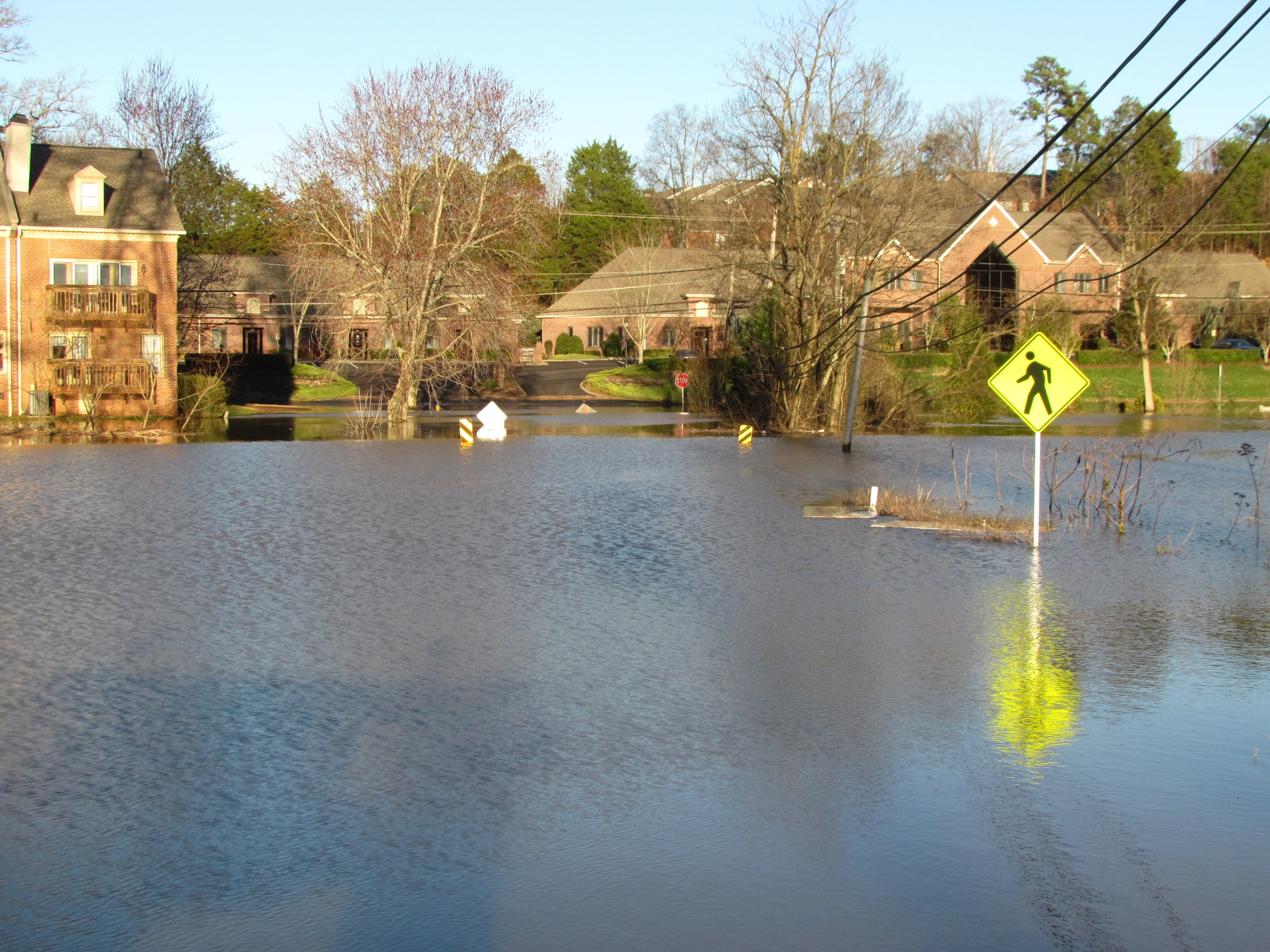 Sinking Creek floodwaters completely overtake George Williams Road in West Knoxville on Sunday, Feb. 24, 2019.
