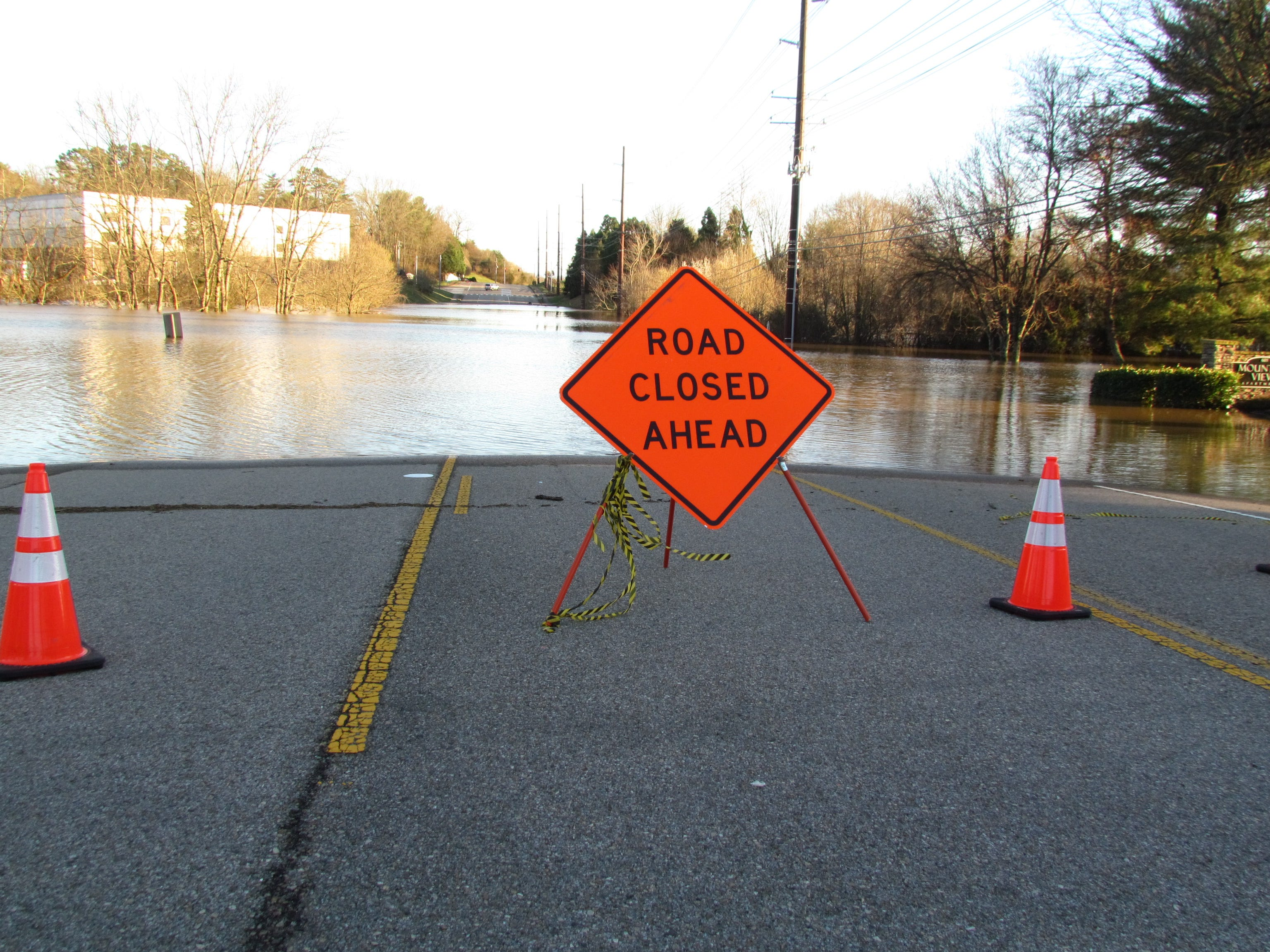 Floodwaters from Sinking Creek overflow across South Peters Road in West Knoxville on Sunday, Feb. 24, 2019.