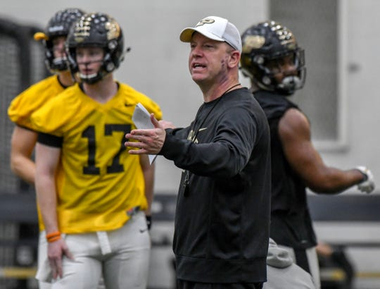 By Frank Oliver for the Journal and Courier --Purdue head football coach Jeff Brohm gives instructions during opening day of spring practice for the Boilermakers on February 25, 2019 in West Lafayette.