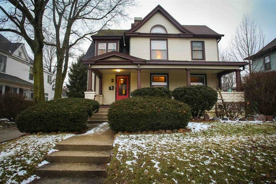 Driving down Ninth Street, the front door of this home is sure to catch your eye, posing as one of the most vibrant on the street.
