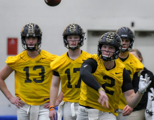 By Frank Oliver for the Journal and Courier --Purdue quarterback Elijah Sindelar throws during opening day of spring practice for the Boilermakers on February 25, 2019 in West Lafayette.