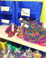 Beads are an essential party favor for Mardi Gras celebrations.