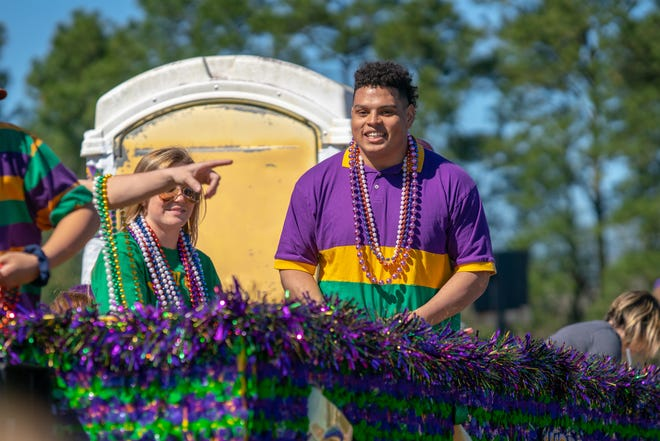 The Scott Mardi Gras parade travels through the city of Scott on February 24, 2019.