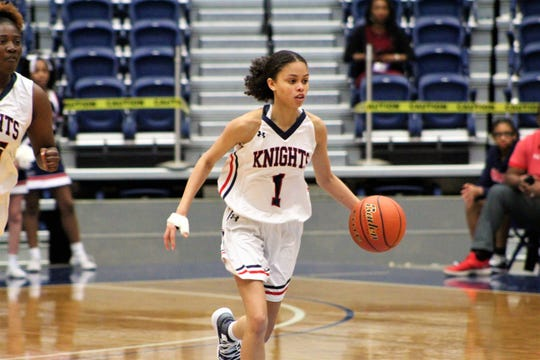 Lafayette Christian junior guard Autumn Chassion (1) brings the ball up court against Ouachita Christian in 2019 LHSAA Division IV semifinal playoff game at the Rapides Parish Coliseum in Alexandria on Monday.