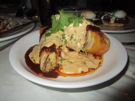Smothered Pork Chimichanga at Blue Dog Cafe