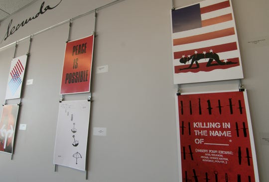 A 'Posters on Politics' exhibit is on display in the Johnson Center of Cleary University Monday, Feb. 25, 2019.