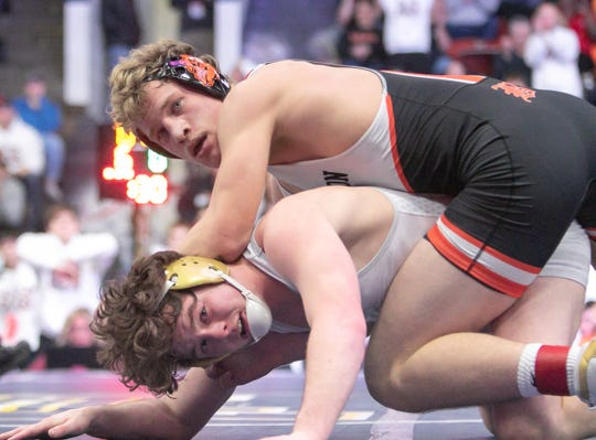 Brighton's Greyson Stevens (top) won his match against Trevor McGowan of Davison in the state Division 1team semifinals on Saturday, Feb. 23, 2019 at Wings Event Center in Kalamazoo.
