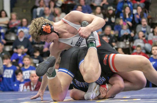 Greyson Stevens of Brighton wrestles Detroit Catholic Central's Easton Turner in the team state championship match in Kalamazoo on Saturday, Feb. 23, 2019.
