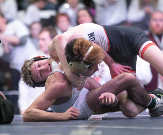 Brighton's Sam Freeman (top) was third in the state at 119 pounds last season.
