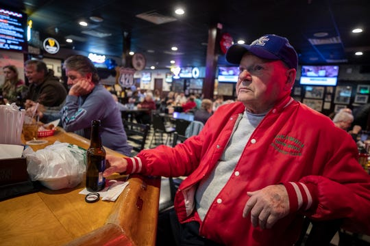 Al Weiter, the Vice President of the Check's Cafe Liar's Club sits at his dedicated seat at Check's Cafe.