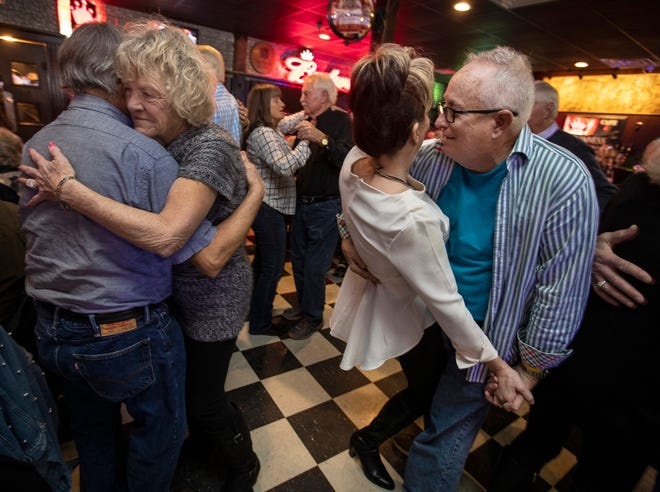 John Norris dips P. J. Jackson, on right, while Joyce Lauyans holds her partner tight on the dance floor on karaoke night at Check's Cafe. Jan. 24, 2019.
