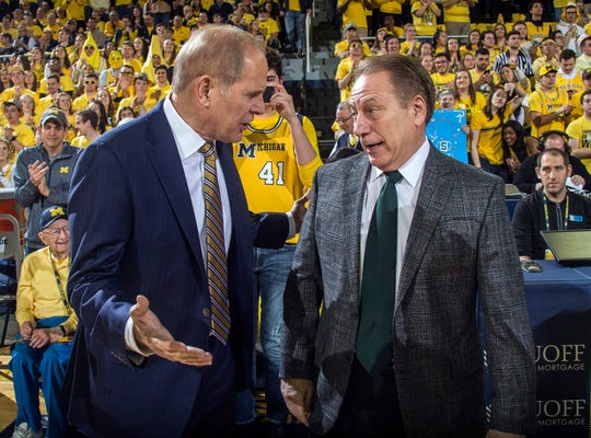 Michigan head coach John Beilein, left, talks with Michigan State head coach Tom Izzo, right, before an NCAA college basketball game at Crisler Center in Ann Arbor, Mich., Sunday, Feb. 24, 2019.