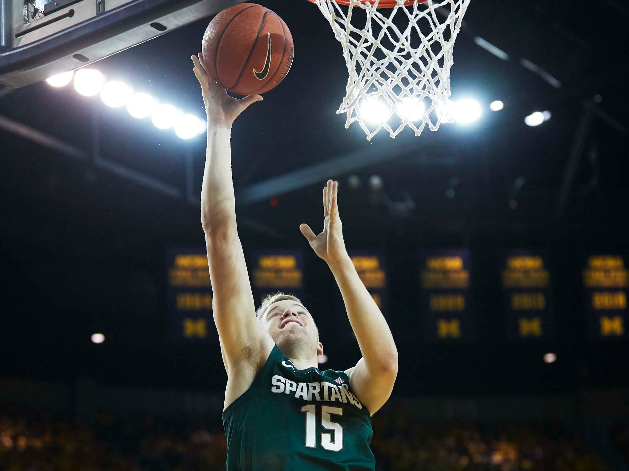 Michigan State Spartans forward Thomas Kithier (15) shoots in the second half against the Michigan Wolverines at Crisler Center.