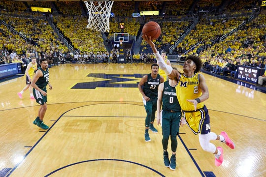 Michigan Wolverines guard Jordan Poole (2) goes to the basket in the second half against the Michigan State Spartans at Crisler Center.