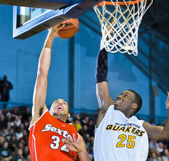 Sexton's Denzel Valentine, left, puts up a shot during a game against Eastern.