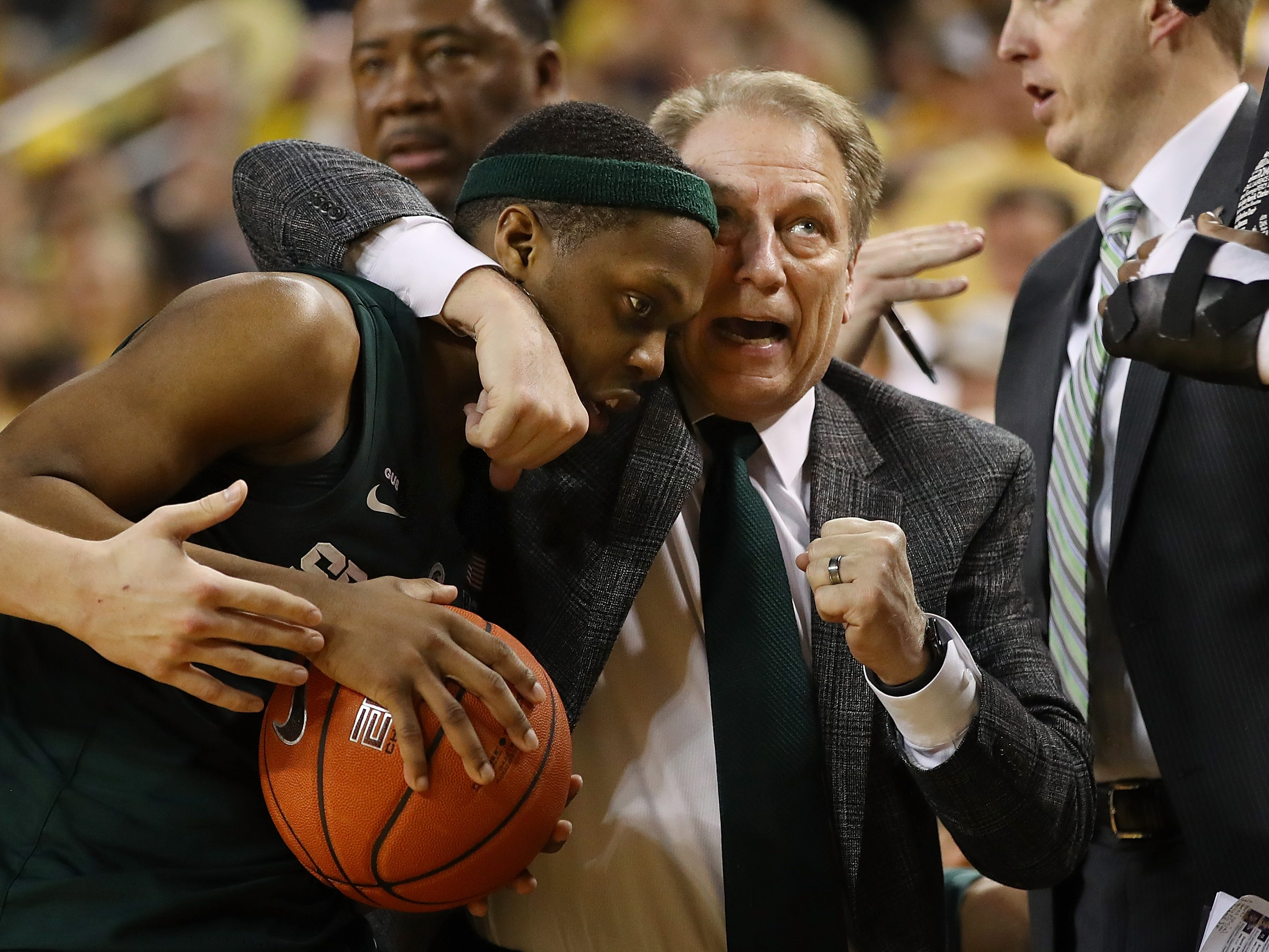 Cassius Winston #5 of the Michigan State Spartans and head coach Tom Izzo react while playing the Michigan Wolverines at Crisler Arena on February 24, 2019 in Ann Arbor, Michigan. Michigan State won the game 77-70.
