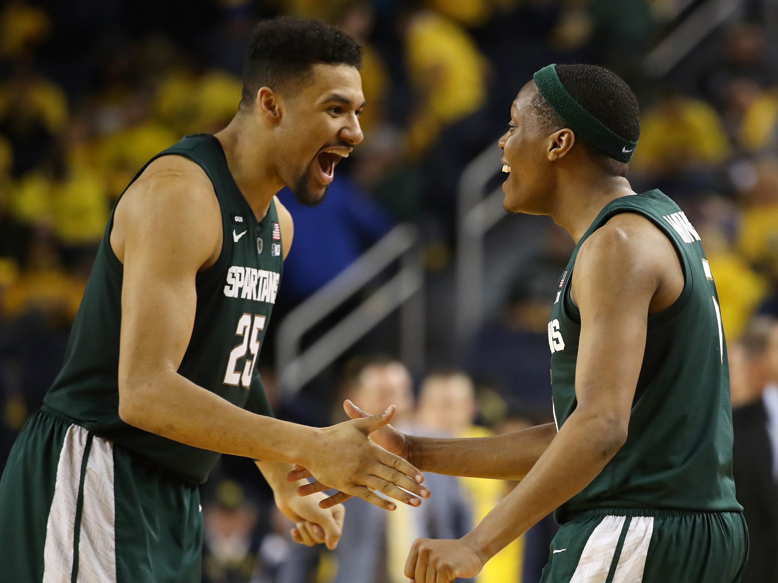 Kenny Goins, left, and Cassius Winston react after Michigan State's 77-70 win over Michigan at Crisler Center on Feb. 24, 2019 in Ann Arbor.