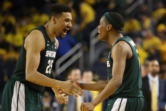 Kenny Goins, left, and Cassius Winston react after the 77-70 win over Michigan.