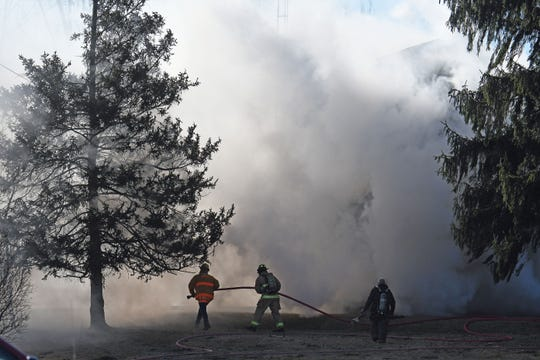 Firefighters battle a blaze at 182 Timmerman Road on Monday morning north of Mansfield.