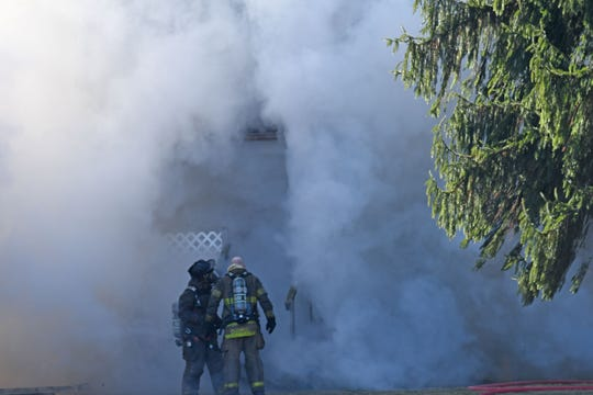 Firefighters had their hands full Monday morning trying to extinguish a house fire at 182 Timmerman Road north of Mansfield.