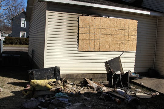 The blaze is believed to have started early Sunday afternoon after cigarette butts were placed into a trashcan inside the home.