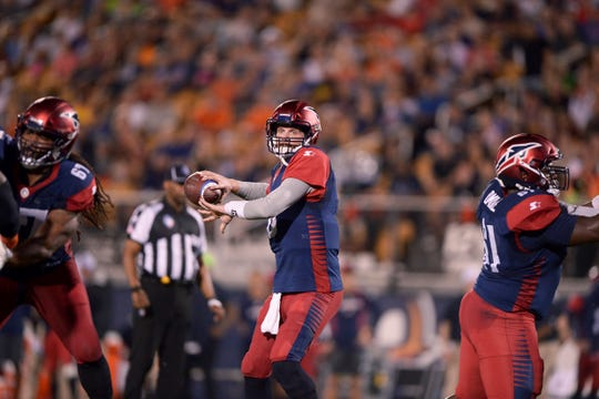 Memphis Express quarterback Zach Mettenberger (8) throws a pass against the Orlando Apollos during an AAF football game, Saturday, Feb. 23, 2019, at Spectrum Stadium in Orlando, Fla. (AP Photo/Rick Wilson)