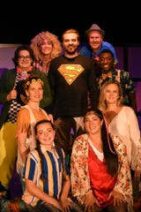 """The cast gathers around Robbie Menegay, playing Jesus. Marco Lutheran Church presents its 25th anniversary revival of the Broadway musical """"Godspell"""" on Feb. 28, Mar. 1 and 2."""
