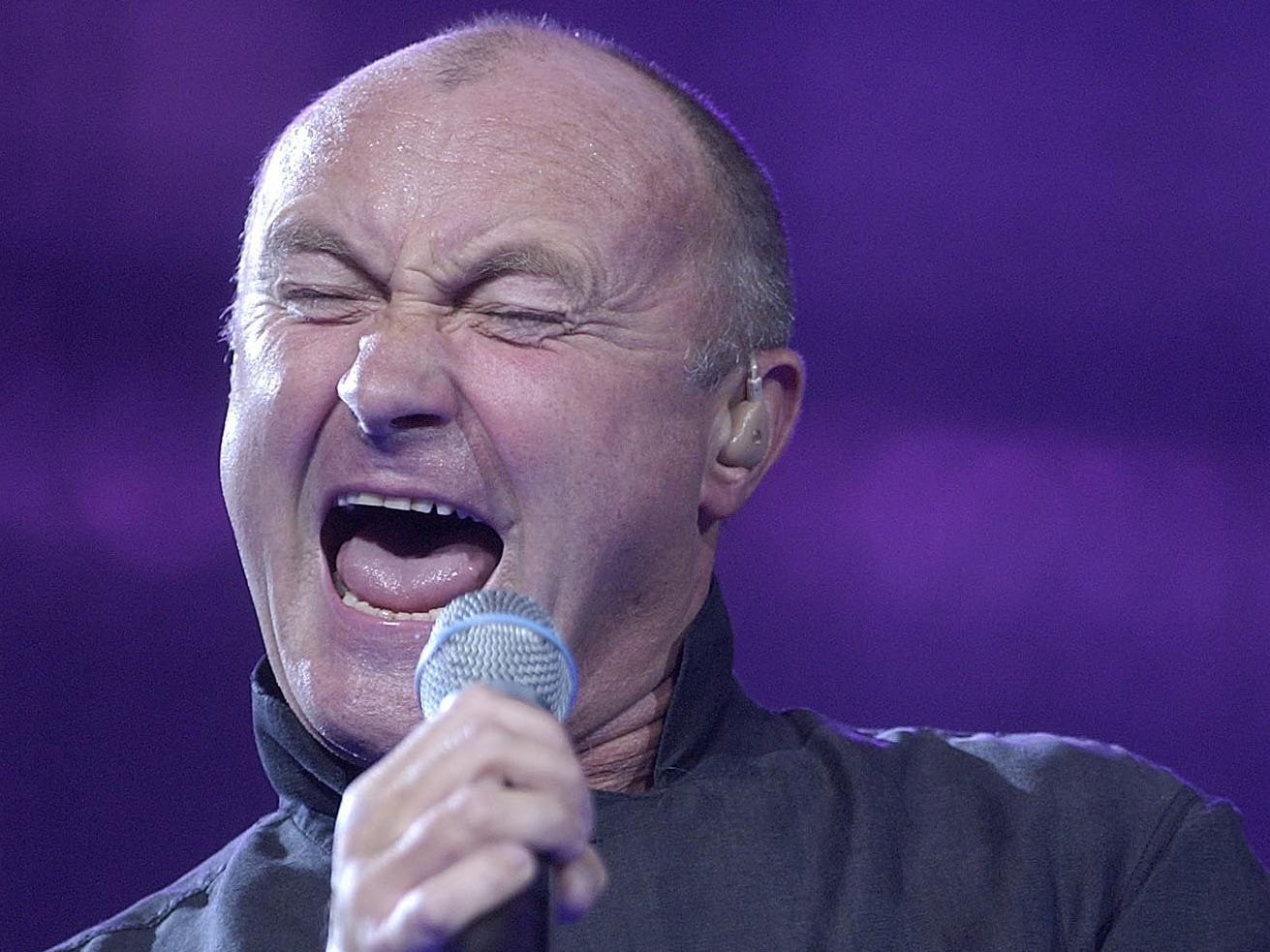 """Phil Collins performs """"Against All Odds"""" during his concert at the Bradley Center on Tuesday, September 7, 2004, part of his First Final Farewell Tour. Collins returned to touring (with Milwaukee native Daryl Stuermer on guitar) in 2017, but has yet to come back to Milwaukee."""