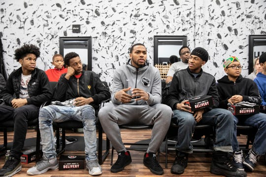 """Bucks player Sterling Brown (center) chats with Milwaukee teens during a recent """"Barbershop Mondays"""" event hosted by the Bucks, Andis Foundation and Safe and Sound."""