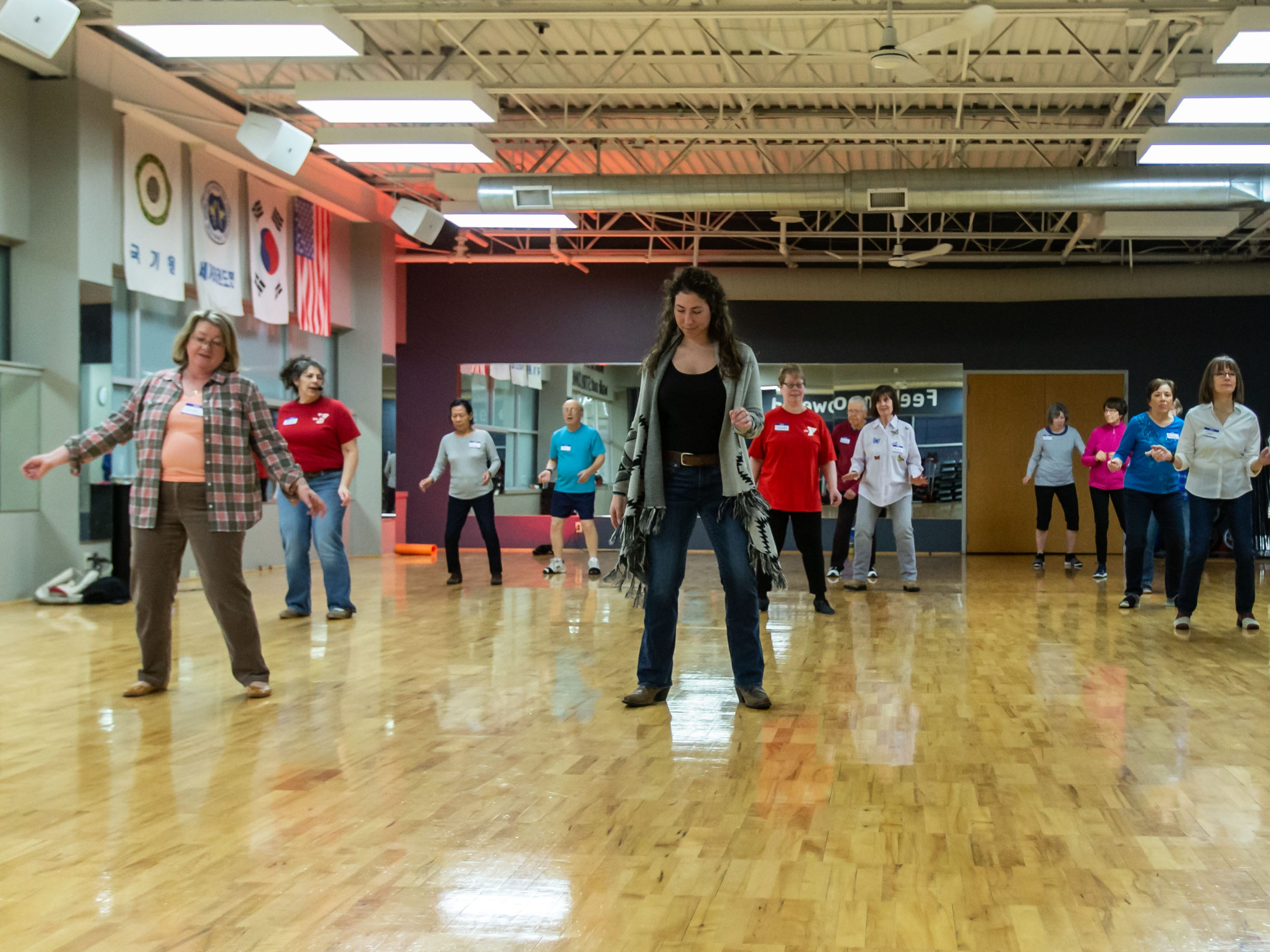 Visitors enjoy line dancing during the Hometown Hoedown NEA Big-Read Kickoff Event at the Tri County YMCA in Menomonee Falls on Saturday, Feb. 23, 2019. The event featured live music, food, games, and western themed activities for the whole family.