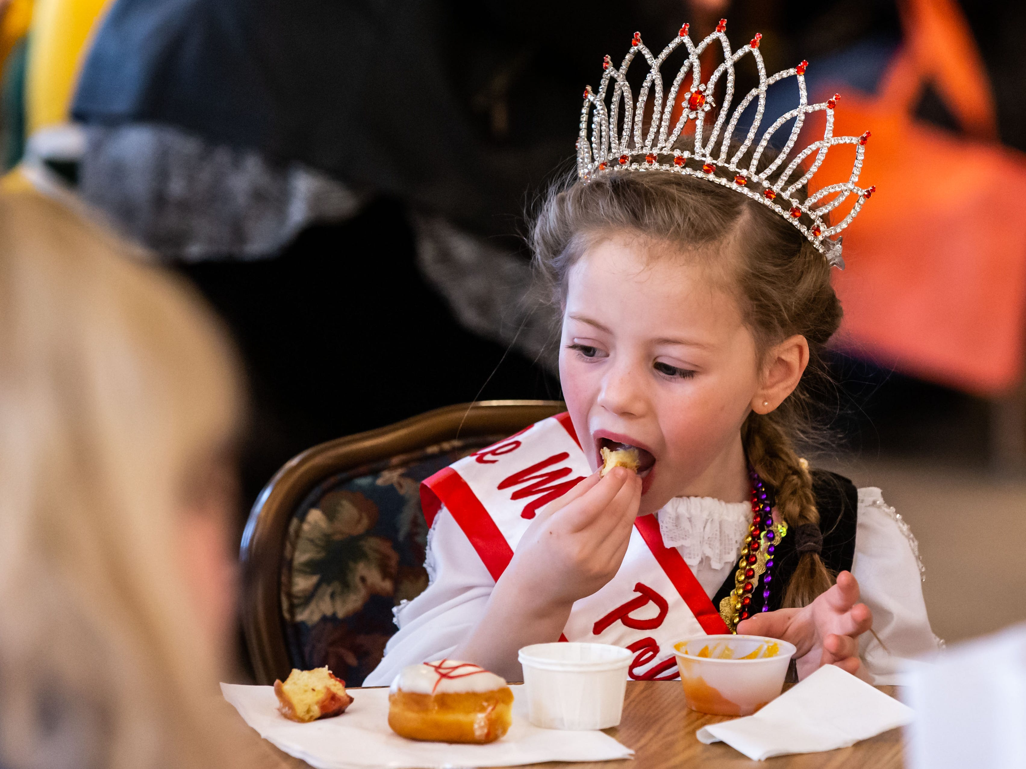 Little Miss Polish Fest, Georgia Gueller, 5, of River Hills, samples a paczek during the Wisconsin Bakers Association's Paczki Preview Party at the Polish Center of Wisconsin in Franklin on Sunday, Feb. 24, 2019. The event showcases some of the best paczki from the area.