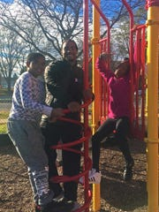 D'Cota Dixon (center) during a visit to Lussier Community Education Center.