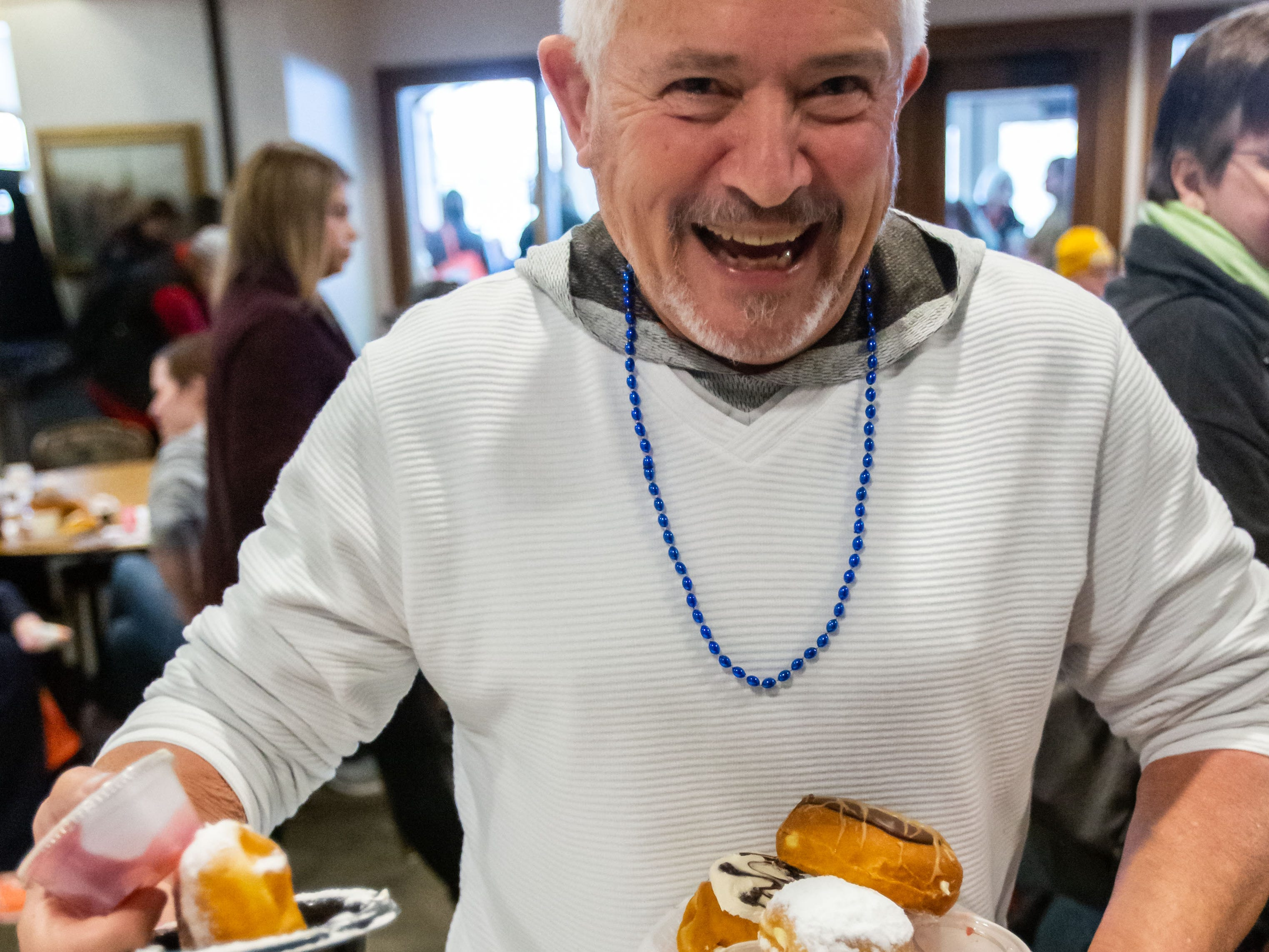 Bob Nelson of Franklin gets ready to sample a variety of flavors during the Wisconsin Bakers Association's Paczki Preview Party at the Polish Center of Wisconsin in Franklin on Sunday, Feb. 24, 2019. The event, which showcases some of the best paczki from the area, also features live music, a special guest appearance by Little Miss Polish Fest and more.