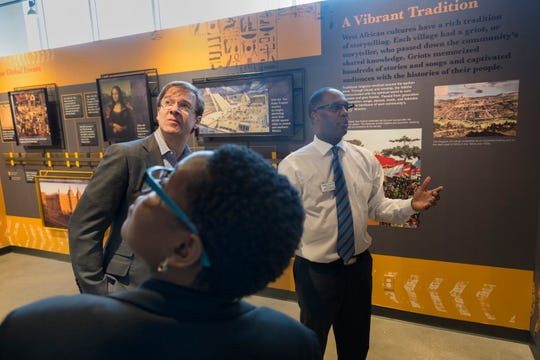 Head griot Reggie Jackson (right) give a tour to Milwaukee County Executive Chris Abele and others Monday, February 25, 2019 at America's Black Holocaust Museum, 401 W.North Ave. in Milwaukee, Wis. The museum plans on reopening to the public later this year.