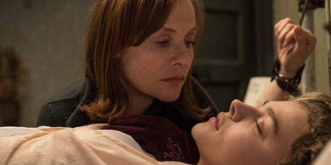 "Greta (Isabelle Huppert) keeps a too-close eye on a young woman (Chloë Grace Moretz) she's lured into her orbit in ""Greta."""