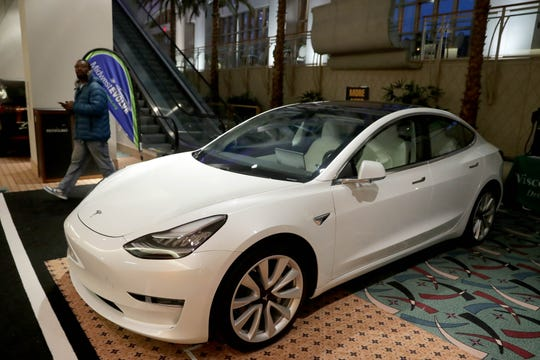 The Tesla Model 3 four-door sedan, which costs around $41,850, according to the Tesla's website, is on display.