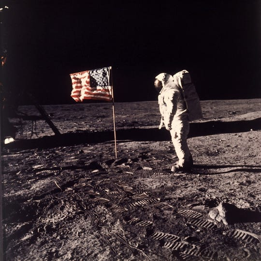 "Astronaut Edwin E. ""Buzz"" Aldrin Jr. stands beside the U.S. flag on the moon during the Apollo 11 mission. The first mission to land a human on the moon is the focus of the new documentary ""Apollo 11."""