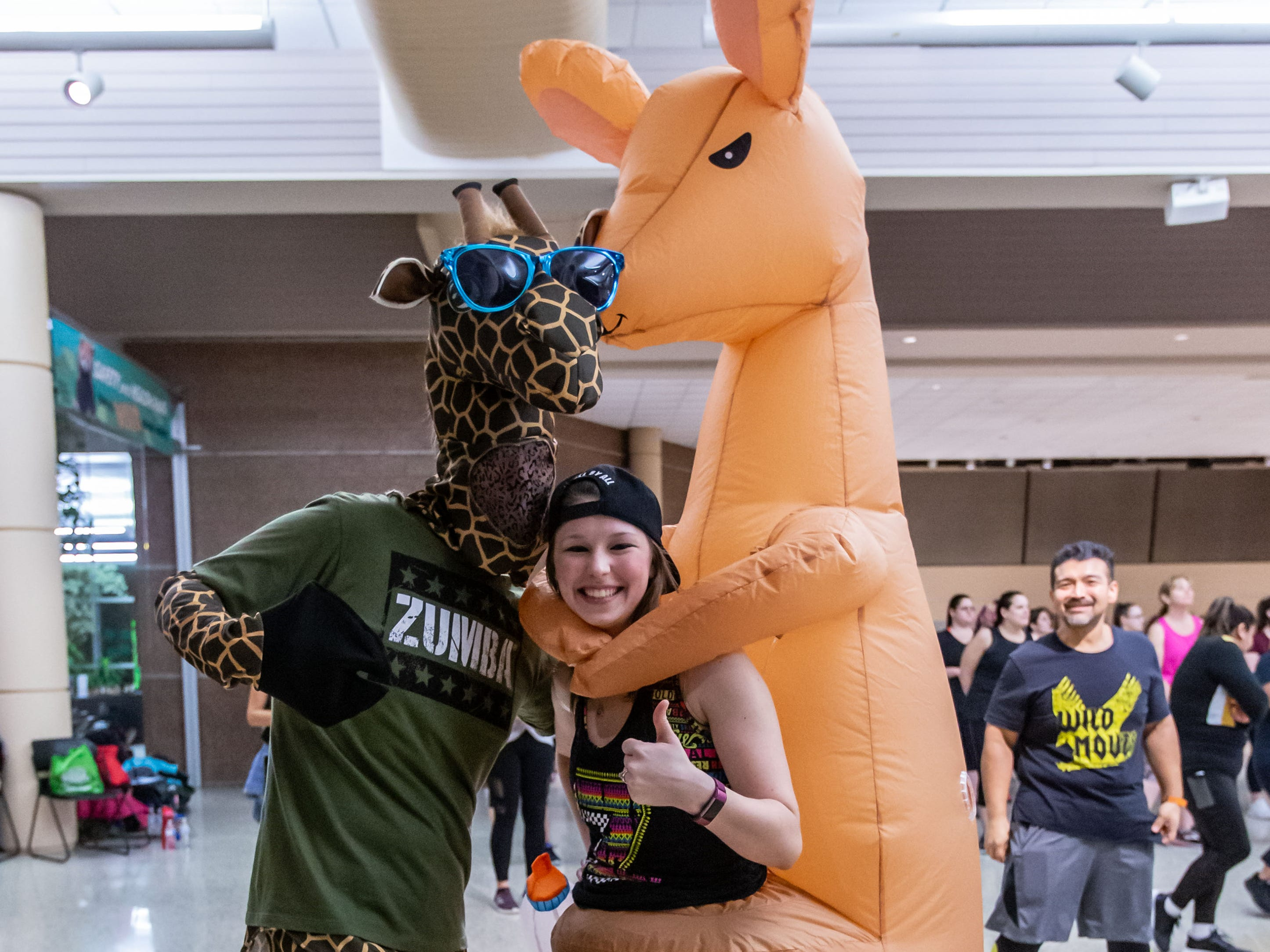 Instructors Brian Kobasick and Janel Martens pose for a photo during the Zoological Society's Zumba Fitness Party at the Milwaukee County Zoo on Saturday, Feb. 23, 2019. Proceeds from the event benefit the Zoological Society's Sponsor an Animal program.