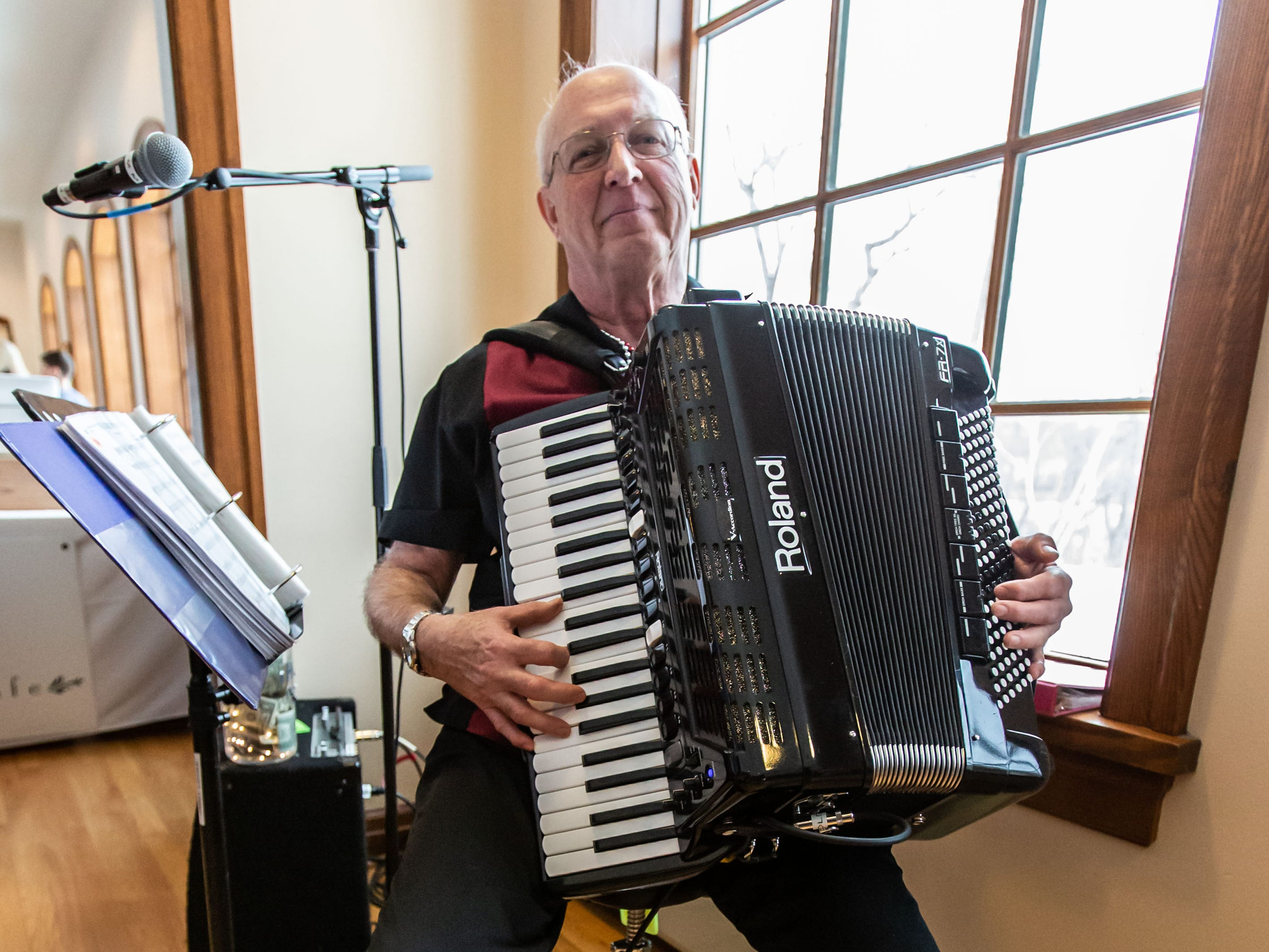 Musician Jimmy Locke of Greendale performs for guests during the Wisconsin Bakers Association's Paczki Preview Party at the Polish Center of Wisconsin in Franklin on Sunday, Feb. 24, 2019. The event showcases some of the best paczki from the area.